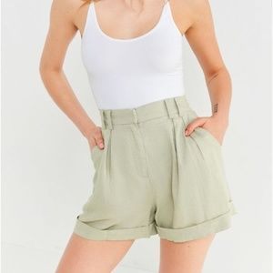 UO Evidnt High Rise Pleated Green Paper Bag Shorts
